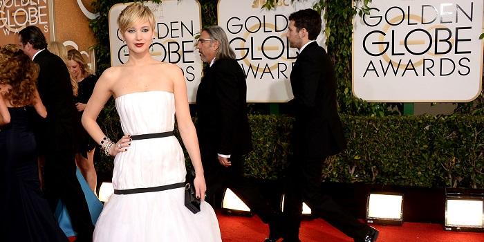 Atriz americana Jennifer Lawrence no evento Globos de Ouro 2014. Foto de Jason Merritt/Getty Images.